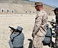 Instructor supervises Afghan Border Police student shoot the AMD-65 rifle (6210679267).jpg