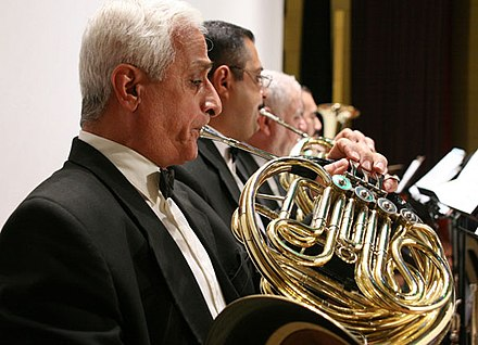 The Iraqi National Symphony Orchestra, officially founded in 1959, performing a concert in Iraq in July 2007. Iraqi National Orchestra.jpg