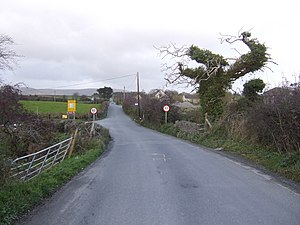 Republic of Ireland–United Kingdom border - The Irish border on the Lenamore Road, County Londonderry, Northern Ireland. The Republic of Ireland begins just in front of the speed signs and lies to the north of Northern Ireland at this location.