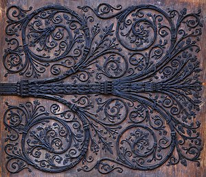 Ironwork - Details of ironwork on the central portal of the west facade of Notre Dame de Paris (France)