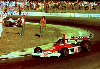 James Hunt - Hunt prematurely celebrates at the 1976 British Grand Prix, he would later be disqualified from the results.