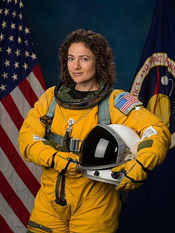 NASA astronaut Jessica Meir in a WB-57 high altitude flight suit, NASA photo jsc2016e165336 (11 October 2016) Source:  NASA Johnson 360px-Jessica_Meir_portrait_in_a_WB-57_flight_suit_%283%29.jpg