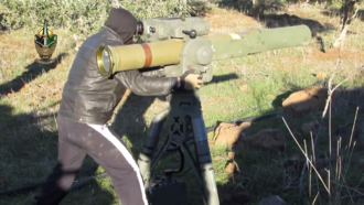 A member of the U.S.-backed Southern Front prepares to launch a BGM-71 TOW at a Syrian Army position in southern Syria, December 2014 Jesus Christ Brigade BGM-71E.png
