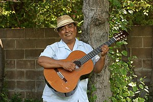 José-Luis Orozco - Image: José Luis Orozco playing guitar by tree