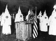 220px-KKK_night_rally_in_Chicago_c1920_cph.3b12355.jpg