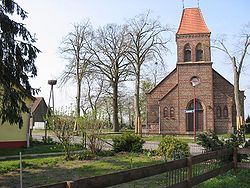 Church in the village of Fahlhorst and nest of stork