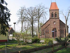 Nuthetal - Church in the village of Fahlhorst and nest of stork