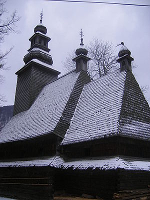 Western Ukrainian clergy - Traditional wooden Ukrainian Catholic Church in Kolochava