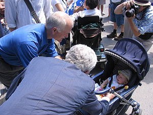 Political campaign - NDP leader Jack Layton and Bloc Québécois leader Gilles Duceppe greet babies - a traditional campaign activity - at the Fête nationale du Québec in Montreal