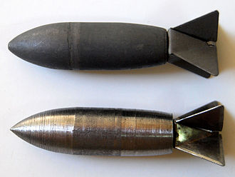 Flechette - Two designs of the Lazy Dog bomb. (Top: early forged steel design, Bottom: later lathe-turned steel design.)