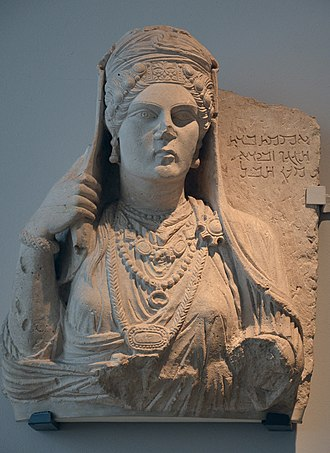 "Palmyrene funerary reliefs - Funerary relief of ""Aqmat"" a fashionable, bejewled Palmyrene woman. The Aramic inscription read ""Aqmat, daughter of Hagagu, descendant of Zebida, descendant of Ma'an. Alas!"". London, England."