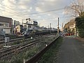Limited Express Train on Kagoshima Main Line at Sangyo-Daigaku Level Crossing.jpg