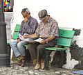Local men on bench, Fuerteventura, Canary Islands (2667785496).jpg