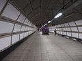 Long walk to the rail station. Heathrow Airport (11371355743).jpg