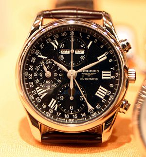 Longines - A Longines self-winding watch with several horology complications—chronograph, moon phase, day, date and month display.