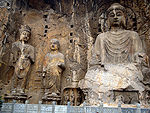 Carved Buddhist deities in a rock face.