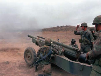 M102 howitzer - The M102 howitzer firing