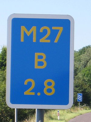 "Driver location sign - A driver location sign marking location 2.8 km on the ""B carriageway"" of the M27"