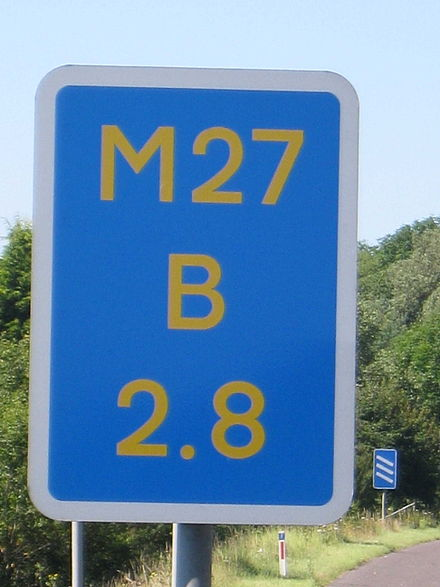Driver location sign used in England to assist drivers when contacting emergency services M27 DLS.JPG