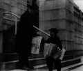 Man buying The Evening Star from newsboy, Washington, D.C 3b16492u (cropped).png