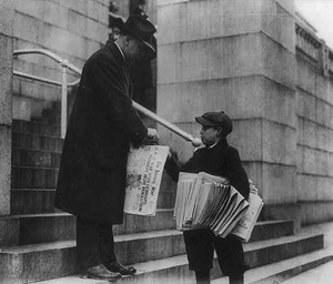 The Washington Star - A young boy sells The Evening Star to a man.