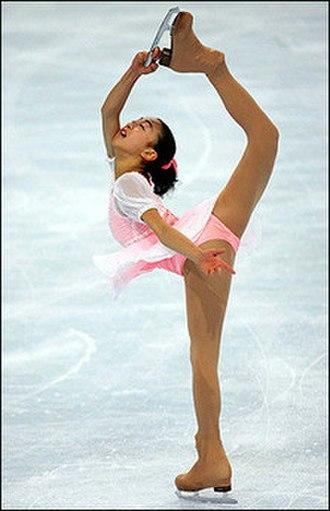 Mao Asada - Asada does a one-handed Biellmann spin during her free skating The Nutcracker (2005–06 season).