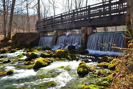 Waterfall under footbridge