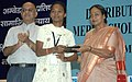Meira Kumar distributing the Scholarships to meritorious SCST students of State Education BoardCouncil Examinations under Dr. Ambedkar National Merit Scholarship Scheme, in New Delhi on May 26, 2008.jpg
