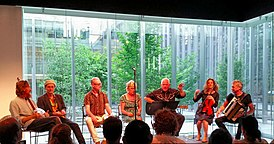 Mekons at the Poetry Foundation on 13 July 2015.jpg