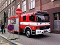 Mercedes-Benz Atego fire engine of Prague, in front of a School.jpg