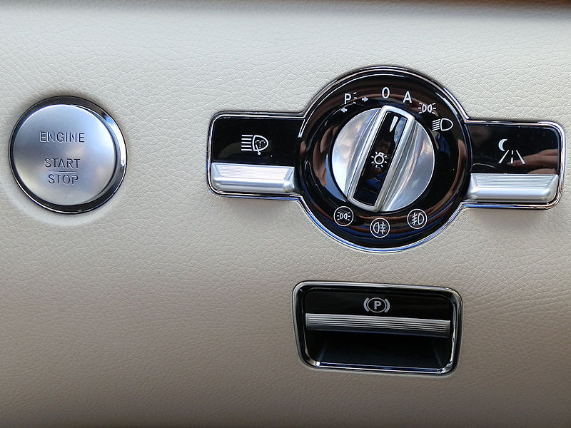 File:Mercedes W221 start button, light switch and parking brake.JPG