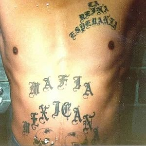Criminal tattoo - A member of the Mexican Mafia has the organization's name tattoed on his abdomen