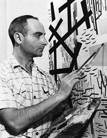 Mimmo Rotella al lavoro nel suo studio, Roma 1951