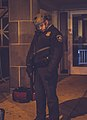 Minneapolis Police Officer with rifle outside 4th Precinct (24406548064).jpg
