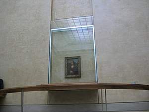 Vandalism of art - The setup of Mona Lisa exhibit in the Louvre.
