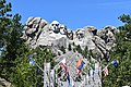 Mount Rushmore over the state flags.jpg