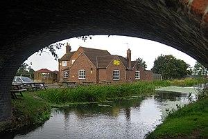 Woolsthorpe-by-Belvoir - Woolsthorpe public house seen though Grantham Canal bridge