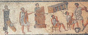 Music of ancient Rome - Musicians in a detail from the Zliten mosaic (2nd century AD), originally shown as accompanying gladiator combat and wild-animal events in the arena: from left, the tuba, hydraulis (water pipe organ), and two cornua
