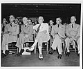 NH 96303 Secretary of Defense Louis A. Johnson (center).jpg