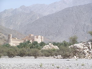 Al Hajar Mountains - The Hajar Mountains rise behind Nakhal Fort