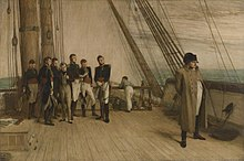 A group of men in military uniform and formal clothes stand to the left, looking towards a single man in a greatcoat and bicorne hat stood by the rail of a ship looking out to sea