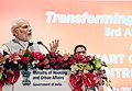 "Narendra Modi addressing the gathering during the event ""Transforming Urban Landscape Third Anniversary of Pradhan Mantri Awas Yojana (Urban).JPG"