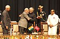 Narendra Modi congratulating Shri Mufti Mohammad Sayeed after swearing-in as Jammu and Kashmir Chief Minister, at Jammu University, in Jammu and Kashmir. The Governor of Jammu and Kashmir.jpg
