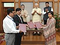 Narendra Modi witnessing the signing of Agreement for transfer of land for construction of memorial for Babasaheb Ambedkar, in New Delhi. The Minister of State for Textiles (Independent Charge) (2).jpg