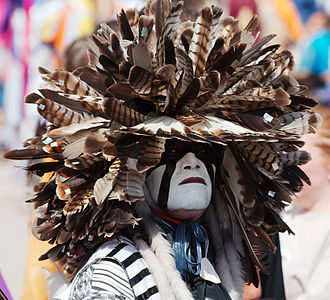 War bonnet - A modern-day Cheyenne dog soldier wearing a feathered headdress during a pow wow at the Indian Summer festival in Henry Maier Festival Park, Milwaukee, Wisconsin. 2008.