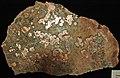 Native copper pods in garnet-pyroxene skarn (Madison Gold Skarn Deposit, Late Cretaceous, 80 Ma; west of Silver Star, Montana, USA) 2.jpg