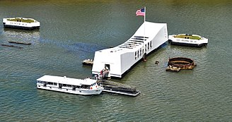 World War II Valor in the Pacific National Monument - The USS Arizona Memorial and the mooring quays of Battleship Row, at Pearl Harbor in Hawaii.