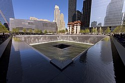 The National September 11 Memorial's South Pool is a black square-shaped fountain, lower than the surrounding plaza.
