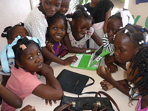 Education and technology - The OLPC laptop being introduced to children in Haiti
