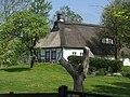 Oesterwurth weisshaus mit baumstumpf.JPG